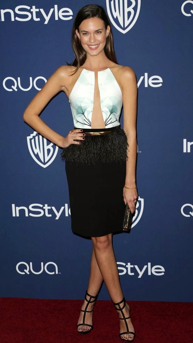 http://www.thefashionspot.com/fashion-news/363249-odette-annable-strikes-a-pose-in-an-intricate-peggy-hartanto-spring-2013-dress/