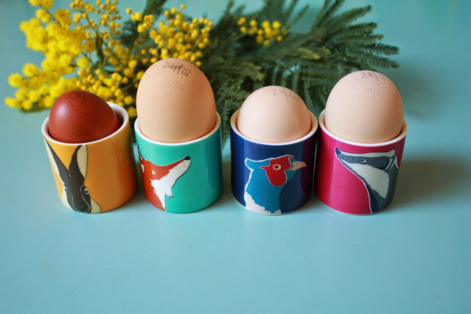 Freshly boiled eggs in pretty little cups