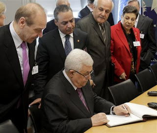 photo of Abbas signing