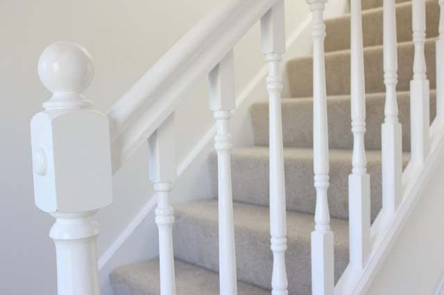 White stair banister and walls
