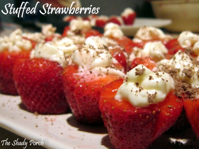 strawberries stuffed with cheesy filling and dusted with chocolate