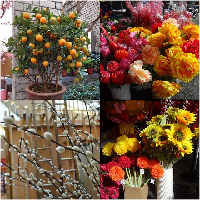 (from left to right) potted mandarin oranges, Chinese  plastic flowers and pussy willows to be deocrated during Chinese New Year in Malaysia