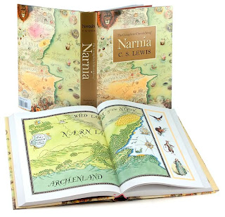 Book cover and inside pages of The Complete Chronicles of Narnia