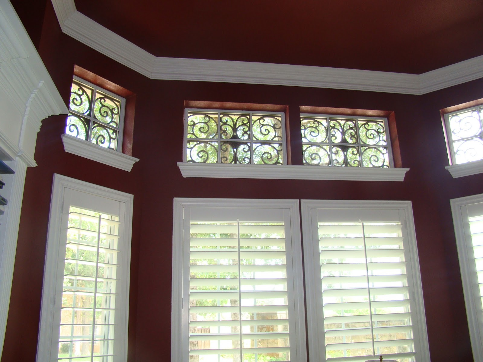 Stunning Check out one of our newest installs in Southlake Texas We did shutters in a painted finish for the formal living and dining and stained shutters