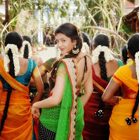 Kajal-agarwal-half-saree-back-All-Azhagu-raja-movie