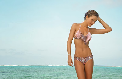 Brazilian supermodel Simone Villas Boas showing off her groovy little body while modeling L Space swimwear