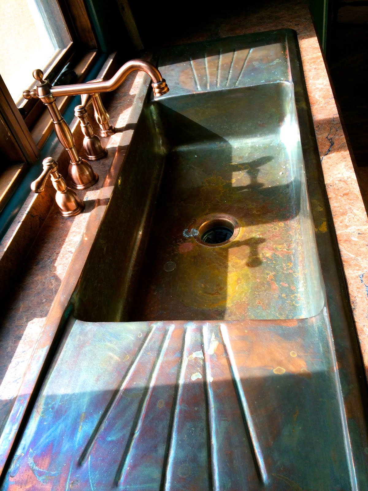 One of a kind copper sink causes kitchen envy.