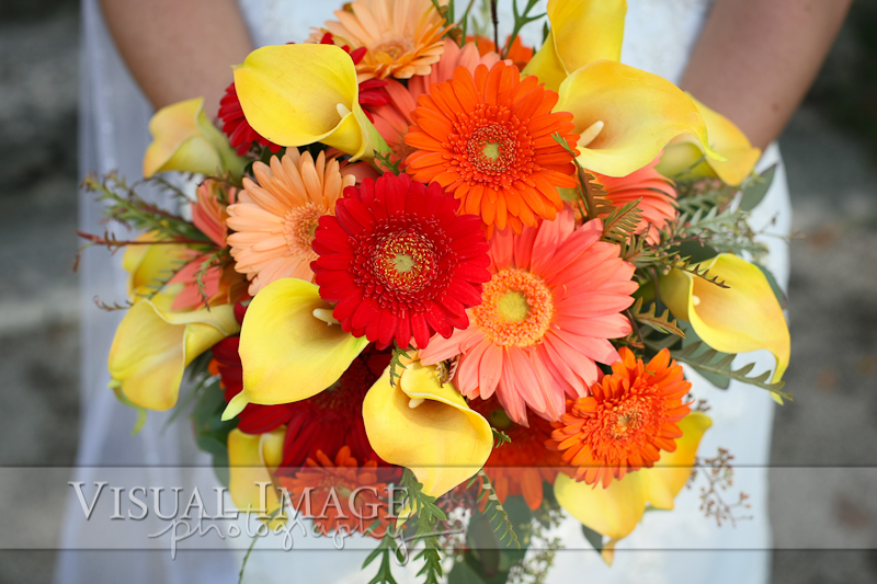 Wedding bouquet of red, orange and yellow flowers