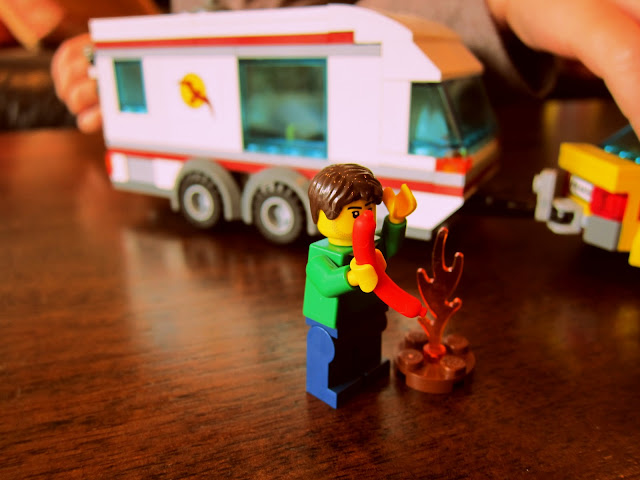 LEGO City caravan man cooking a sausage on the fire
