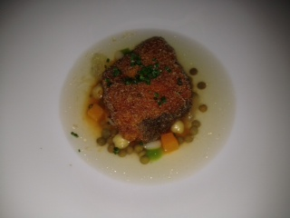 An ordinary fried cod with rose pepper, white bean, lentils, carrots ...