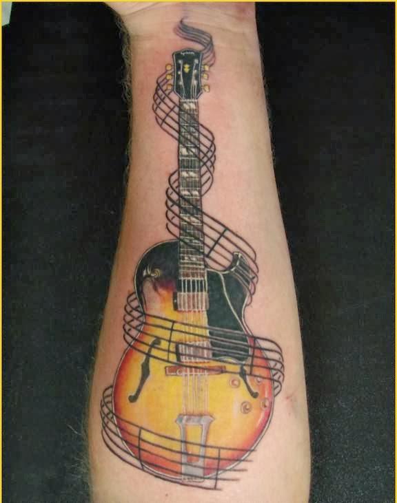 Cool guitar tattoos de...
