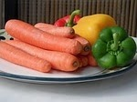 An image of Carrots and other vegetables on a plate