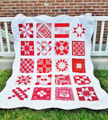a red and white sampler quilt