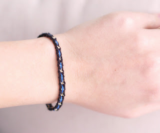 "Delicate and feminine 'thin blue line"" bracelet made from vintage gold chain with black and blue embroidery thread woven into it"