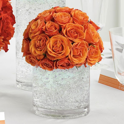 wedding centerpiece with orange roses