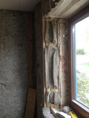 3 layers of insulation by window reveal, small section of wall that can't be insulated as to do so would prevent window from opening
