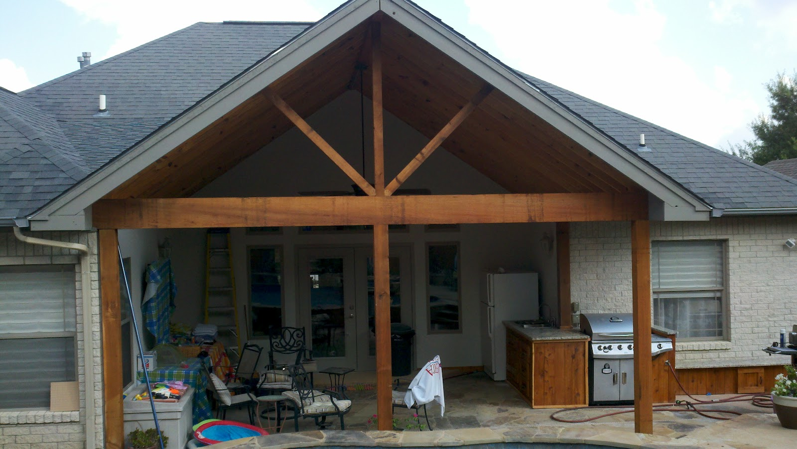 Covered porch with outdoor kitchen ryan and tiffany of for Covered back porch