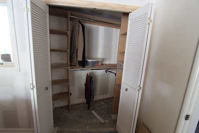 New closet with louver doors part of mid-century modern remodel