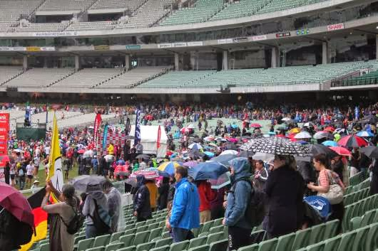 The spectators waiting at the finish inside the MCG