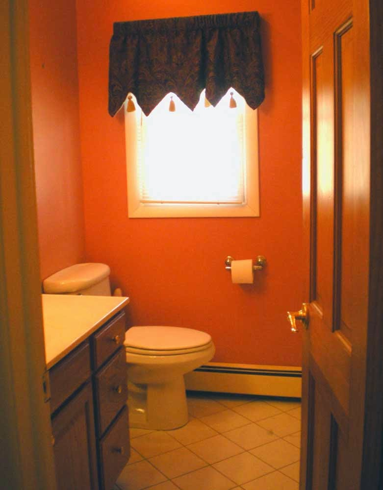 Simple small bathroom remodeling orange design ideas for Small restroom remodel ideas