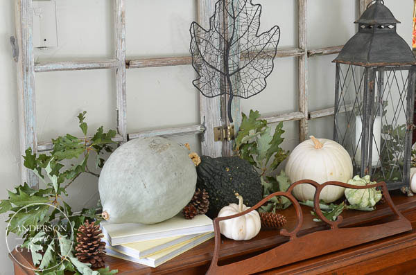 Create an interesting fall display using pumpkins, squash, and gourds in shades of green and white.  |  Farmhouse Fall Home Tour at www.andersonandgrant.com