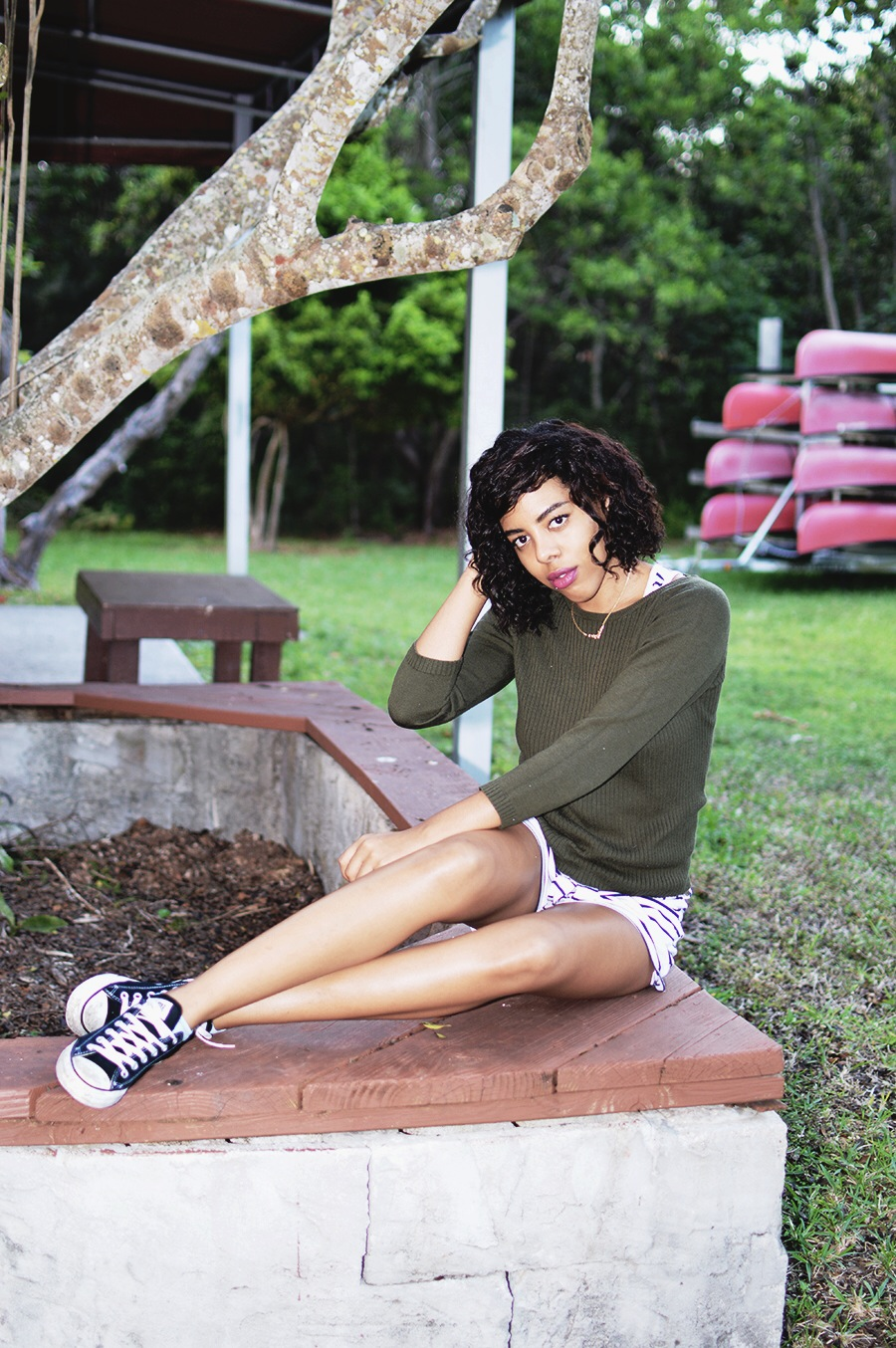 indie fashion blogger anais alexandre of down to stars in a simple yet classic olive sweater with striped romper