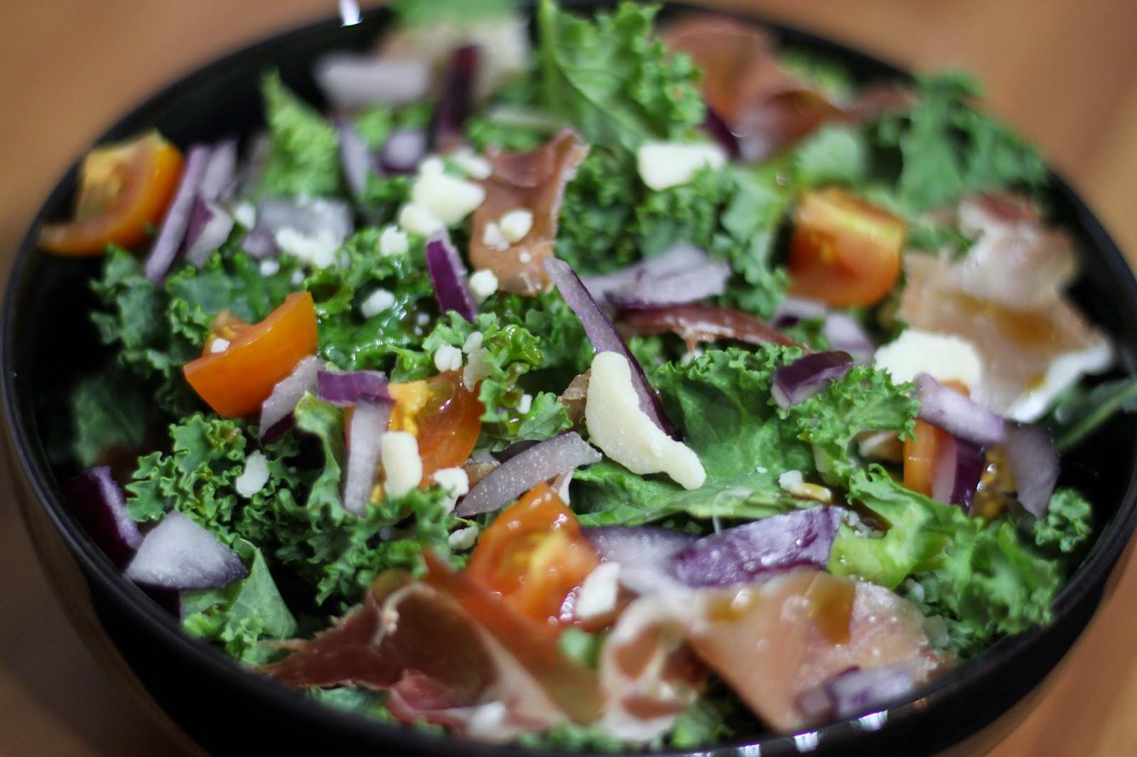 kale salad recipe - parmesan, parma, tomato, onion, olives and balsamic vinegar