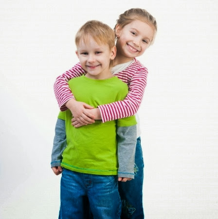 namc montessori encouraging positive behavior girl and boy hugging