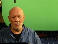 Brian Vike sitting in front of a green screen for the Discovery Channel TV UFO documentary.
