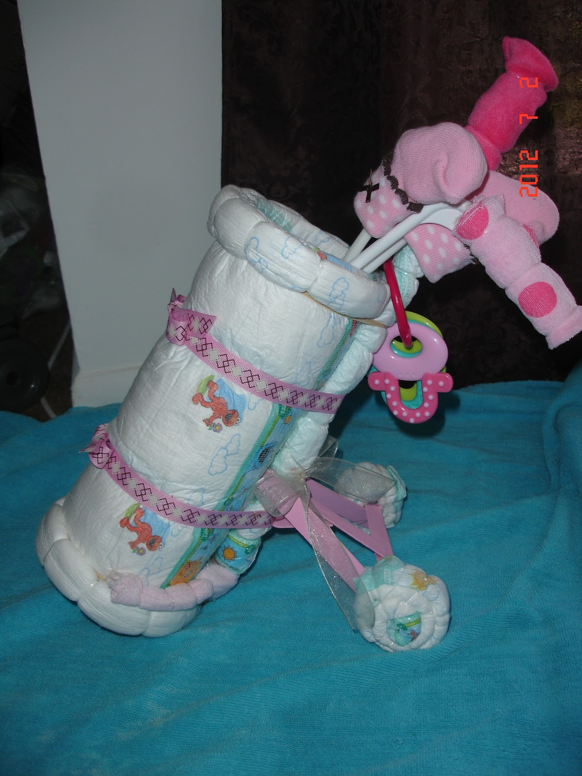 Cake Decorating Bag Instructions : How To Make A Tractor From Diapers Ehow Party ...