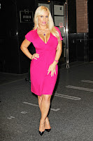 Coco Austin cleavage in a tight dress