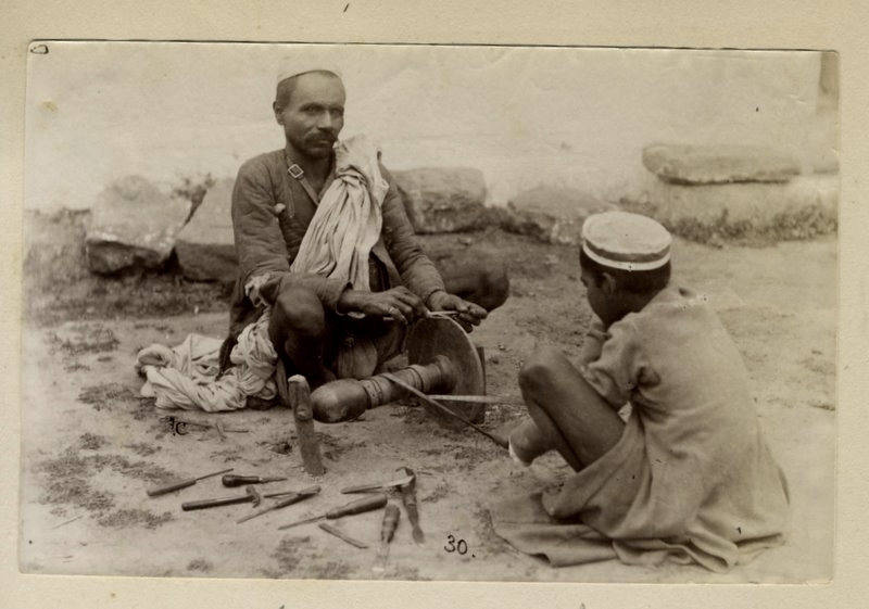 Two Men Sharpening Knives with a Stone Wheel - 1880's