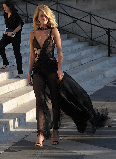 Rosie Huntington Whiteley exposing her sexy body ass side boobs nipple sin black transparent clothes Atelier Versace show at Paris Fashion Week