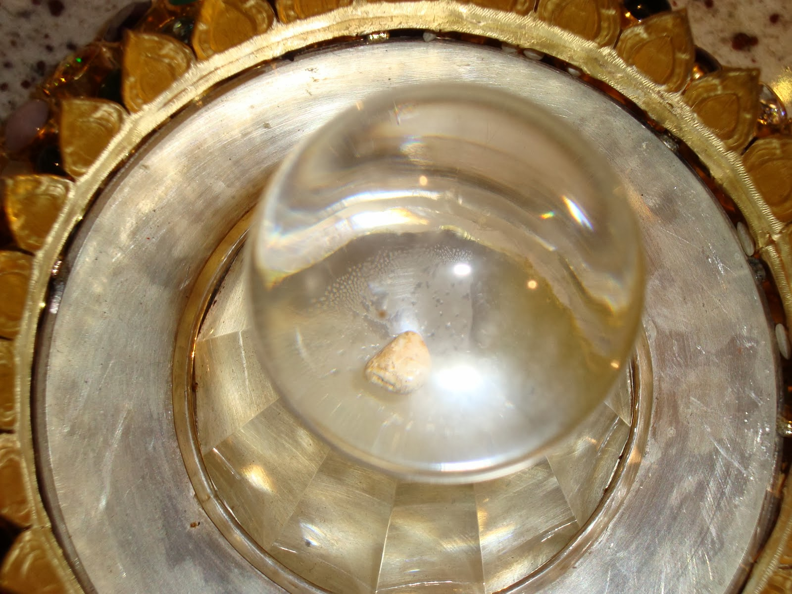 What Are the Pearl-Like Objects Found in Monks' Ashes After Cremation?