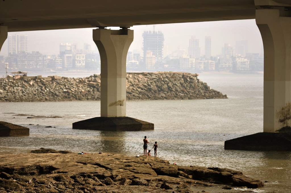 Photo of people at the waterfront near the Bandra-Worli Sea Link in Mumbai in India