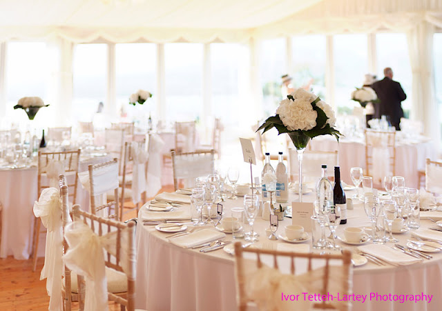 A 30 image bokeh panorama of reception tables in a marquee.