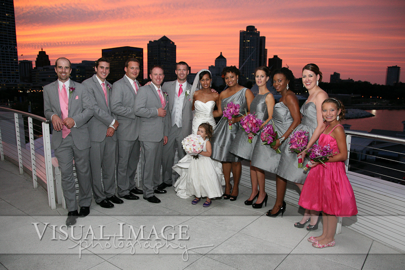 Wedding party at Discovery World with orange sunset in Milwaukee