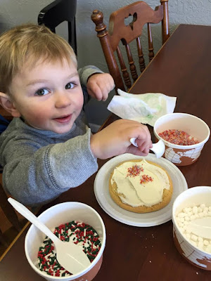 Carter decorating his cookie.
