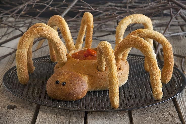 Bread spider that holds spinach dip. Made from dinner rolls