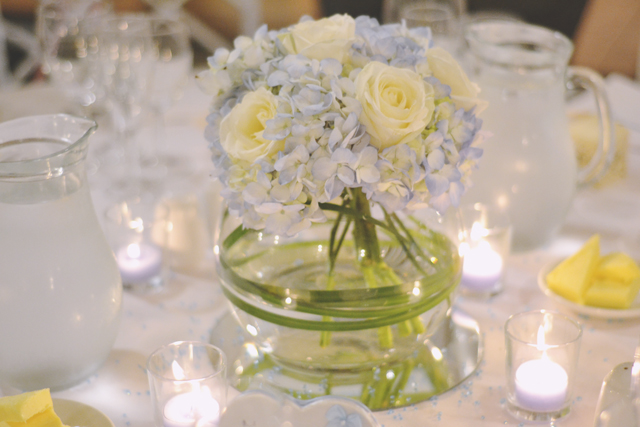 Blue hydrangea cream rose centrepiece