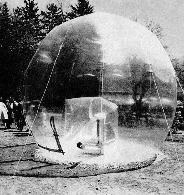 a transparent inflatable sculpture shown in a transparent sphere, architects, sphere architecture, pneumatic design