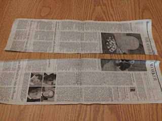 sheet of newspaper, torn in half