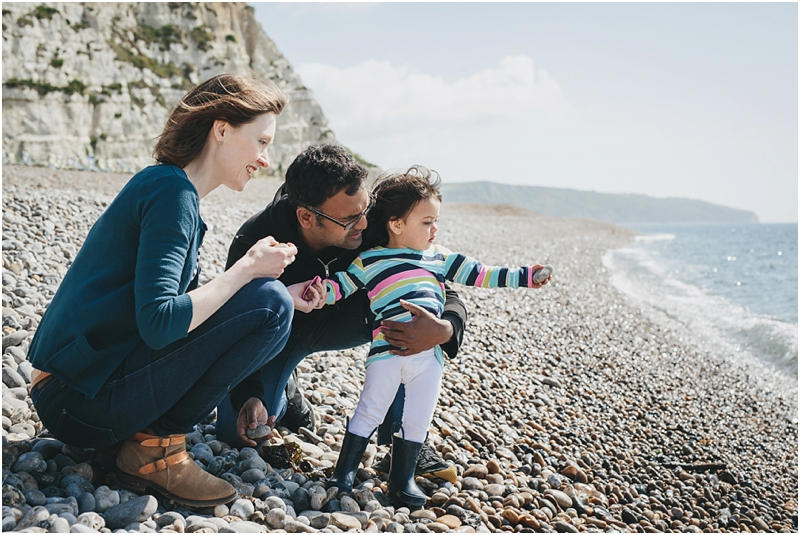 A family watching the waves at the beach