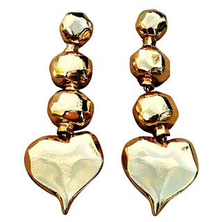 Vintage 1990's gold dangling heart shaped earrings by Christian Lacroix.