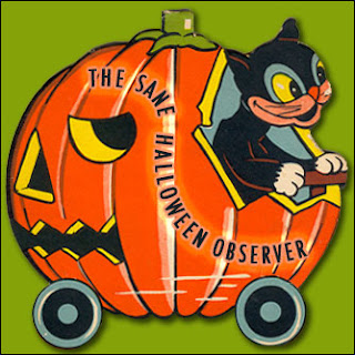 Black cat driving a Jack O'Lantern car from a vintage halloween candy container circa 1940s.