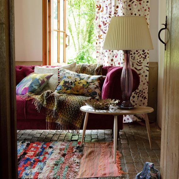 gorgeous mix of colors and prints for a boho style living room the