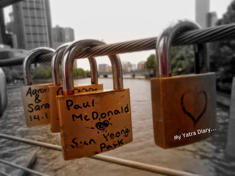 Love locks along the Yarra River footbridge, Melbourne in Australia