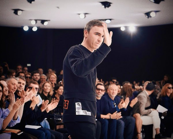 Raf Simons wears Raf Simons Fall Winter 2014 patchwork sweatshirt at Christian Dior womenswear Spring Summer 2015 show
