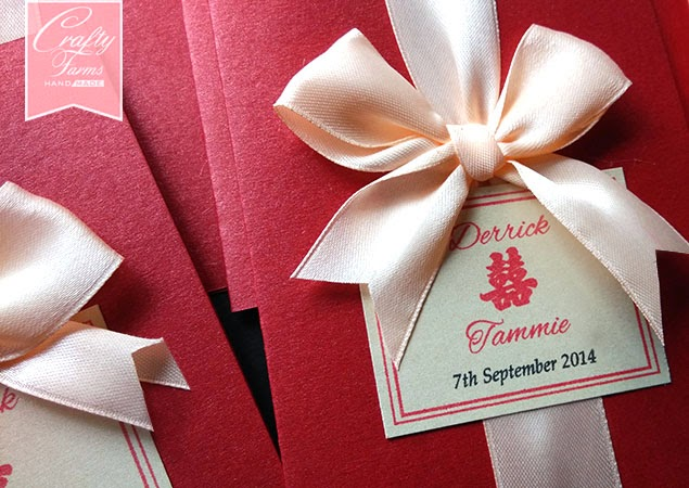red double happiness Chinese wedding card with peach colour ribbon bow