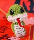 http://www.ravelry.com/patterns/library/lucky-snake-crochet-amigurumi-free-pattern
